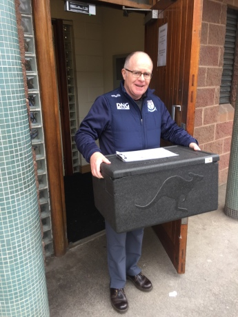 Donagh O'Brien Picking up Meals On Wheels delivery.