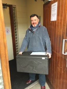Seamus Daly Picking up Meals On Wheels delivery.